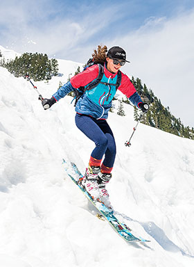 woman downhill skiing